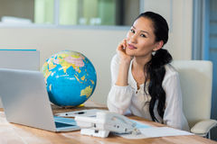 Pretty travel agent smiling at camera Royalty Free Stock Images