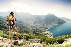Pretty traveler woman with backpack on a mountain Stock Image