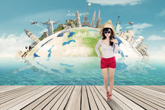 Pretty traveler with the world monument background Royalty Free Stock Photos