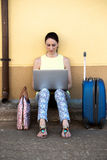 Pretty travelling woman consulting a travel destination for your Stock Image