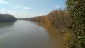 Pretty trees along north side of Wabash river. Just south of Williamsport Indiana looking southwest down river taken on.November 3 2018 royalty free stock image