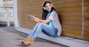 Pretty trendy young woman enjoying her music stock video