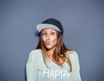 Pretty trendy young woman flirting with the camera Royalty Free Stock Image