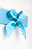 Pretty turquoise blue bow and ribbon on a gift box Stock Photography
