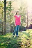 Pretty tween girl outdoors. Twelve year old girl outdoors in a forest in beautiful evening light Royalty Free Stock Images