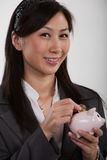 Pretty twenties asian businesswoman. Showing concept of savings Stock Images