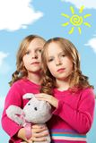 Pretty twins Stock Images
