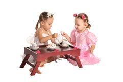 Pretty Twins Sisters Have Tea Isolated Stock Images