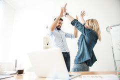 Pretty two workers are celebrating their success stock photography