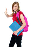Pretty university student showing thumbs up sign Royalty Free Stock Photography
