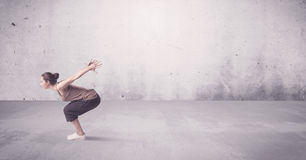 Pretty urban dancer with empty background. A beautiful young hip hop dancer dancing contemporary urban street dance in empty clear grey wall background concept Royalty Free Stock Photos