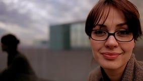 Pretty urban woman. Pretty woman in an urban setting stock footage
