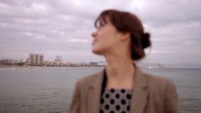 Pretty urban woman. Pretty woman in an urban setting stock video