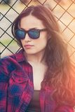 Pretty urban young woman portrait with sunglasses Stock Photo