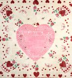 Pretty Valentine`s Day Card with Pink Doily Heart on a Vintage Handkerchief. Heart is blank for your copy, text, words or design. Square flat layout photo from Stock Photos