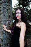 Pretty vampire near tree Royalty Free Stock Images