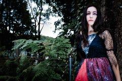 Pretty vampire near tree Stock Photo