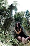 Pretty vampire near tree Stock Image