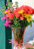 Pretty vase filled with colorful variety of flowers Royalty Free Stock Image