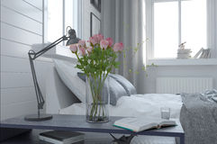 Pretty vase of fresh pink roses in a bedroom Royalty Free Stock Photos