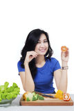 Pretty vegetarian woman holds tomato Stock Photography