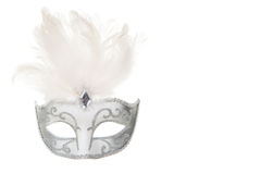 Pretty venetian silver and white carnival mask with feathers iso Royalty Free Stock Images