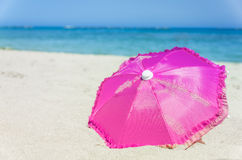 Pretty vibrant pink beach umbrella Stock Images