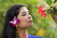 Pretty Vietnamese girl with a flower in her hair Royalty Free Stock Photography