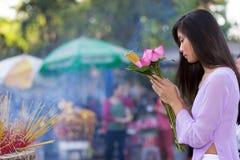 Pretty Vietnamese girl praying Stock Photos