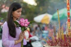Pretty Vietnamese girl praying Stock Image