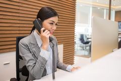 Pretty Vietnamese receptionist Royalty Free Stock Photos