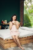 Pretty vietnamese woman enjoying her morning coffee at home Stock Photography
