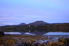 Pretty View of MacLeod's Tables Reflected in the Loch. MacLeod's Tables reflected in Dunvegan Loch in Scotland Stock Images