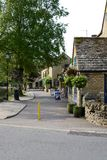 The pretty village of Bourton on the water. Early morning view of main street and along the River Windrush, Bourton-on-the-Water, Gloucestershire, Cotswolds Royalty Free Stock Photography