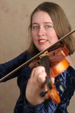 Pretty Violinist 2. A pretty young woman playing classical violin Stock Photos