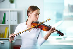 Pretty violinist Stock Image