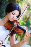 Pretty violonist Stock Image