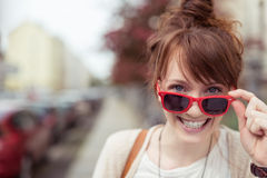 Pretty vivacious woman in trendy red sunglasses Royalty Free Stock Image