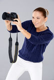 Pretty vivacious young female phoptographer Royalty Free Stock Image
