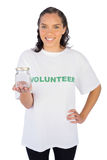 Pretty volunteer woman holding jar Stock Image