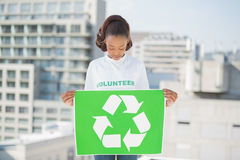 Pretty volunteer woman holding recycling sign Stock Image