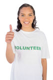 Pretty volunteer woman with thumb up Stock Image