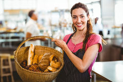 Pretty waitress carrying basket of bread Royalty Free Stock Photo