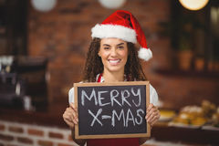 Pretty waitress with a chalkboard merry x-mas Stock Images