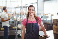 Pretty waitress leaning on counter Royalty Free Stock Image