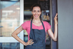 Pretty waitress leaning on the wall Royalty Free Stock Image