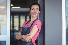 Pretty waitress leaning on the wall Royalty Free Stock Photo