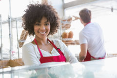 Pretty waitress posing with arms crossed. At the bakery Royalty Free Stock Images