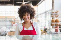 Pretty waitress posing behind the counter Royalty Free Stock Images