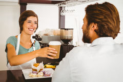 Pretty waitress serving happy customer Stock Images